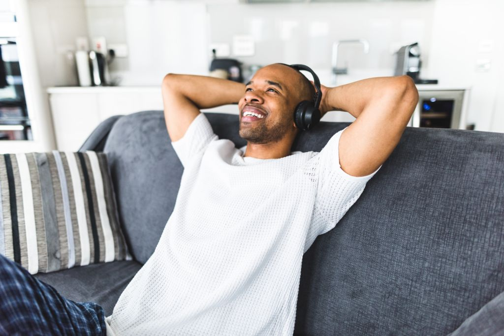 man listening music on the couch