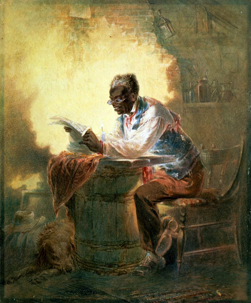 African American man reading a newpaper.