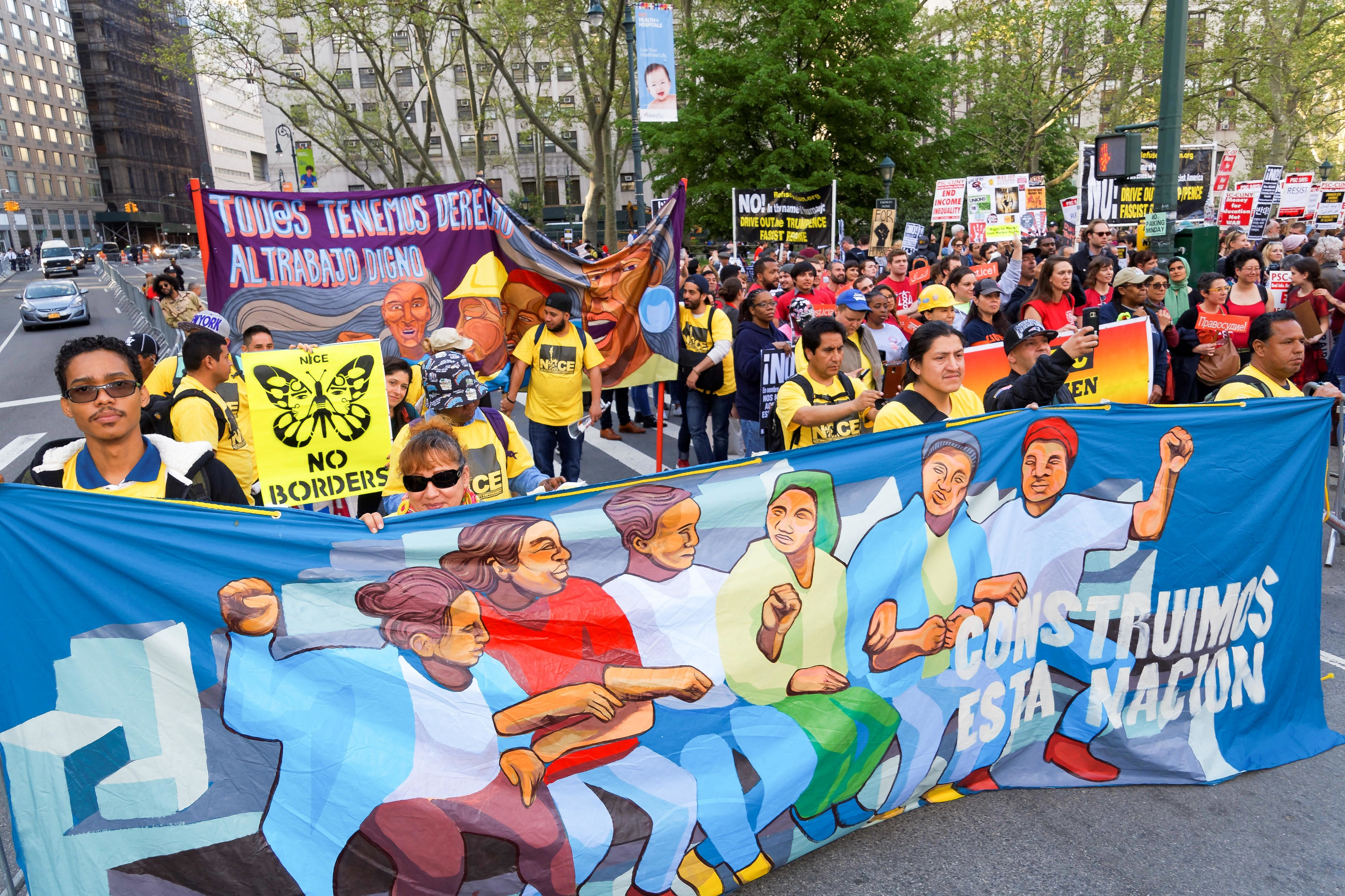 May Day protesters hold signs in Foley Square, Manhattan.
