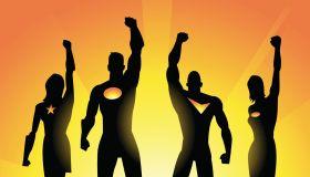 Superheroes Team Raising Fist in Silhouette