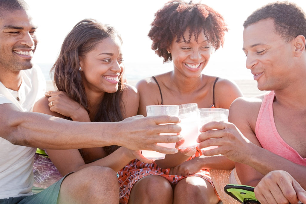 Friends toasting each other on beach