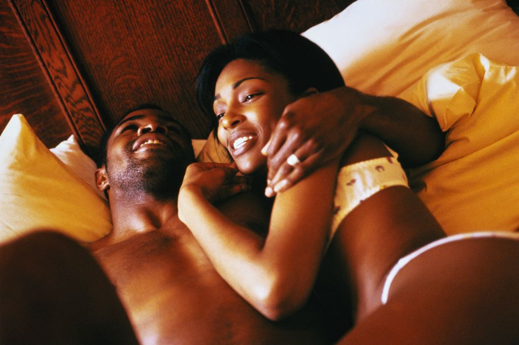 Young couple embracing in bed