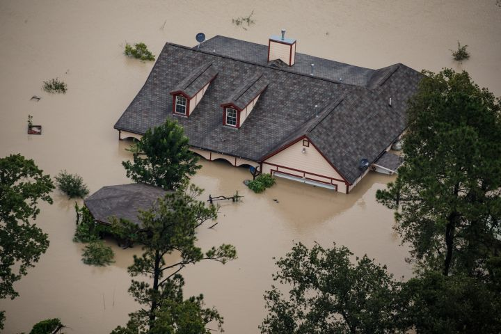 A house is completely submerged in flood water.