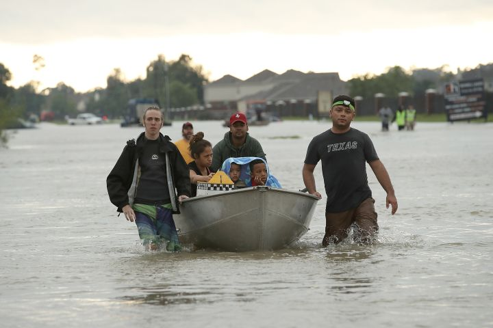 The Tellez family evacuates their home.