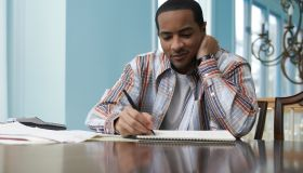 Man Calculating His Bills at Home