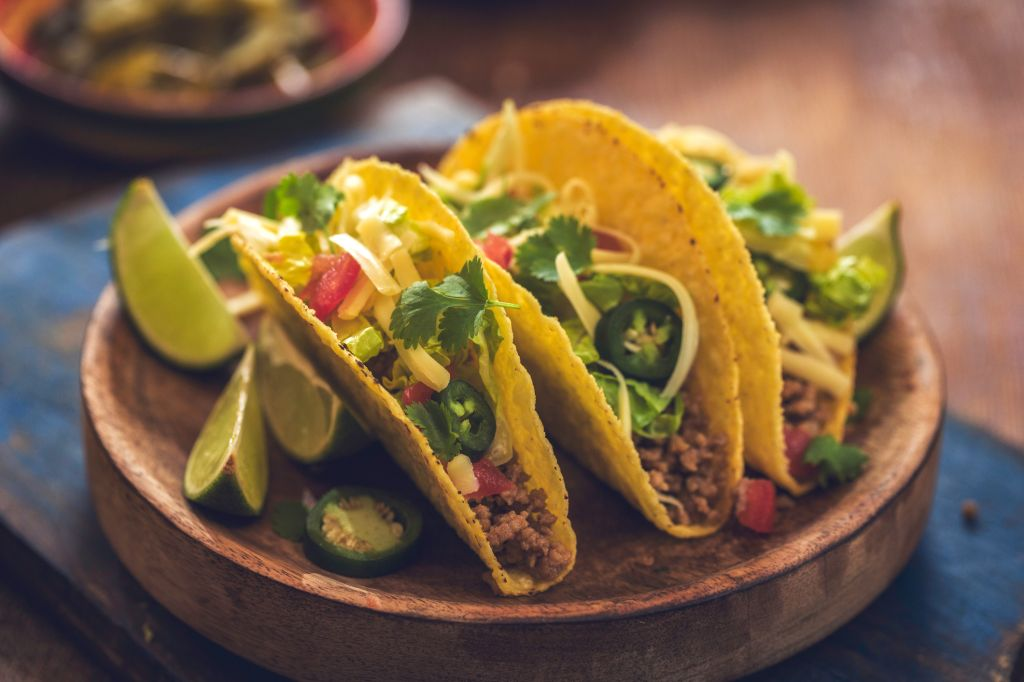 Mexican Tacos with Spicy Salsa, Minced Meat and Guacamole