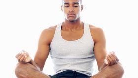 A man meditating in lotus position
