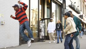USA - New York City: Harlem, West 125th St.: Youngster dancing on the sidewalk.