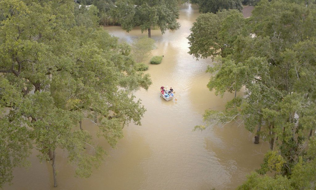 Rescue boat approaches, flooded street, Hurricane Harvey
