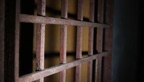 Close-Up Of Rusty Metallic Gate Prison Bars