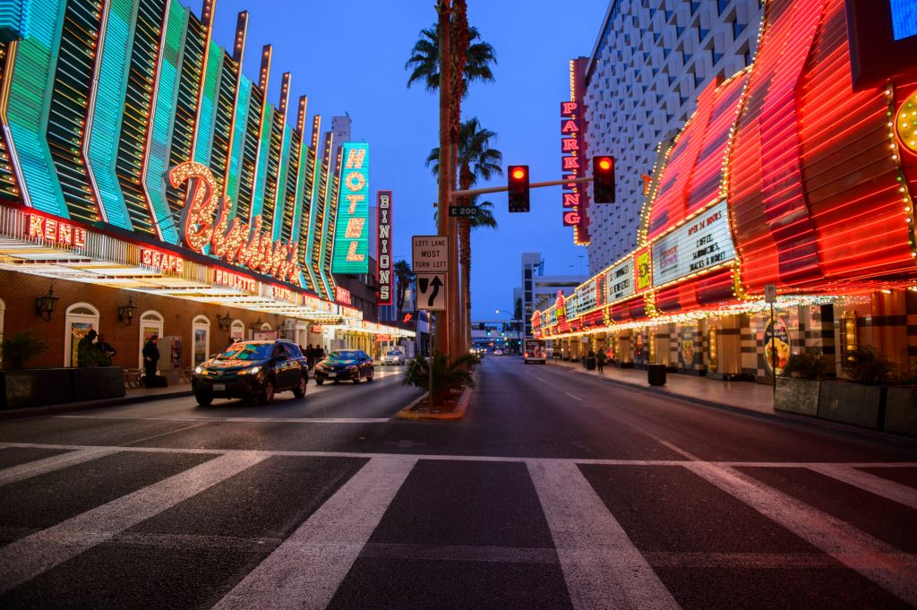 Road signs and casino hotel at Fremont Street in downtown Las Vegas, Nevada, USA