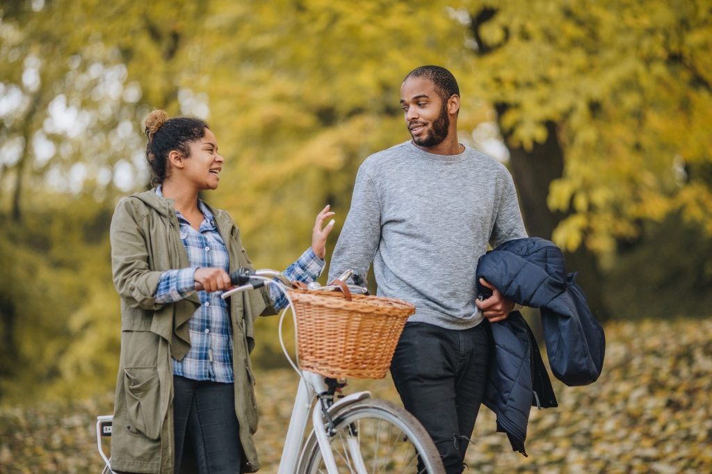 Young black couple taking a walk in autumn and talking.