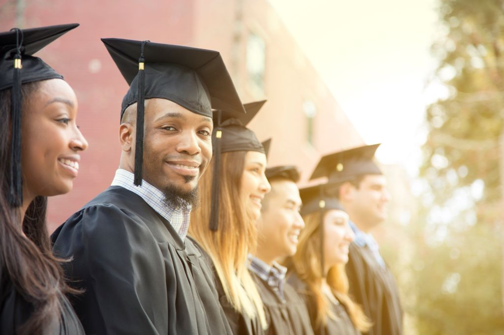 African descent male college student graduation on campus.