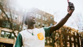 A Young Man Takes Selfie in Downtown Seattle