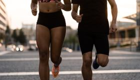 Cropped image of fit jogger couple