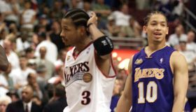 031213.SP.0610.lakers33.GF–Laker Tyronn Lue cracks a smile as Sixer Allen Iverson can only scratch h