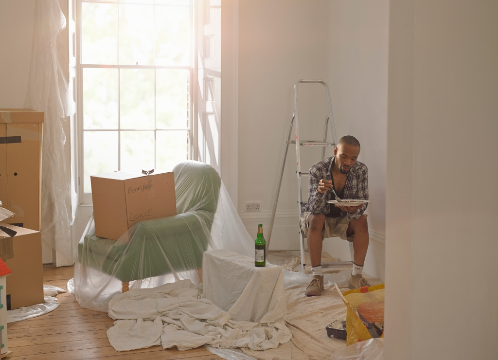 Man taking a break from doing DIY in his new home