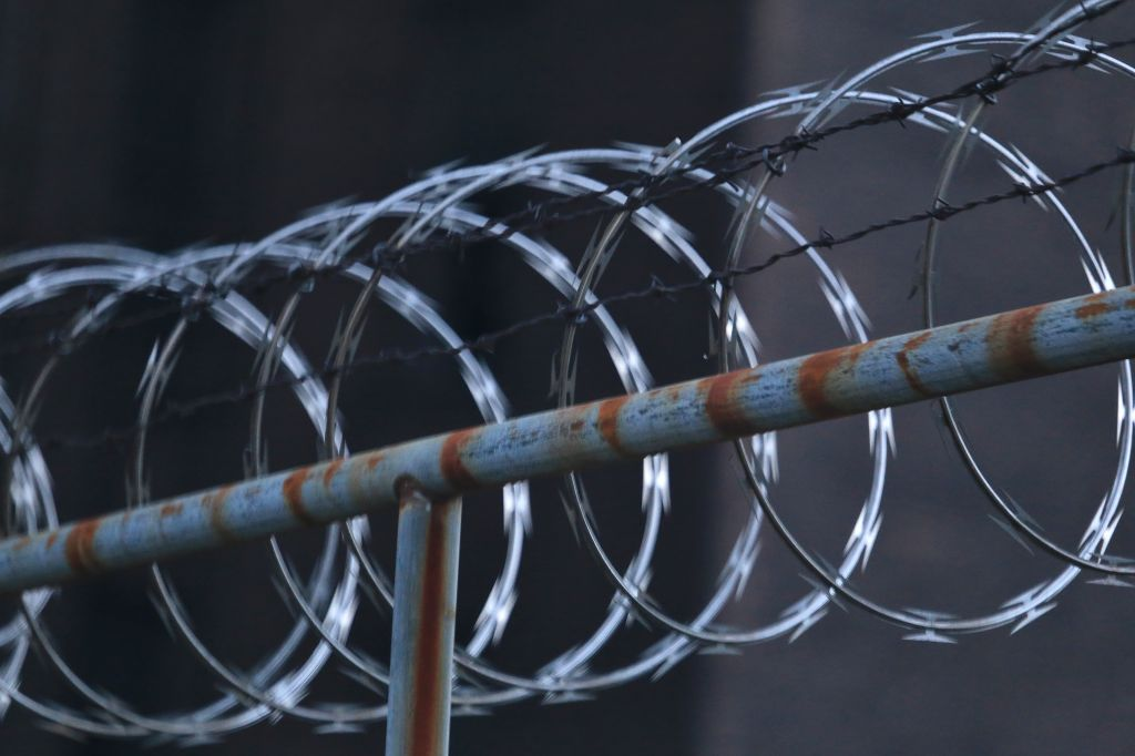 Close-up of Concertina wire on the prison fence