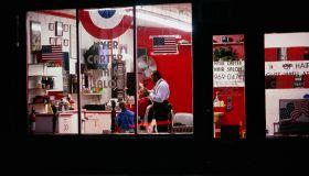 Man Receiving Haircut in Barber Shop