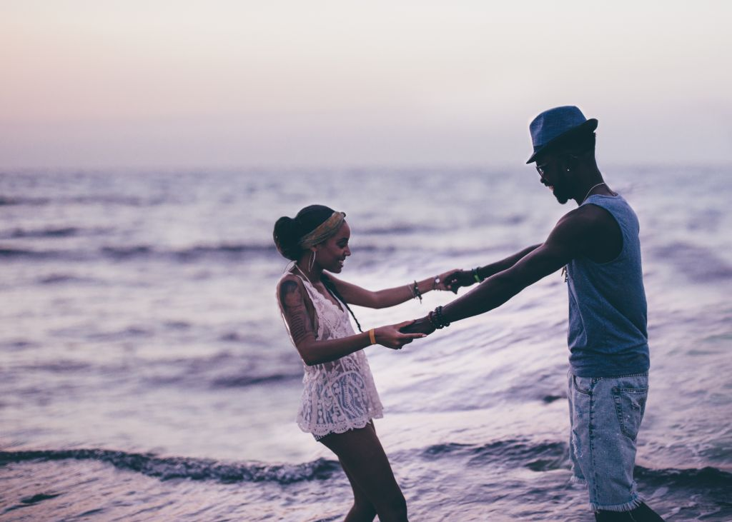 Young couple in love having fun at the beach