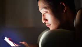 Night time and millenials with smart phone