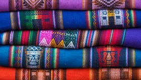 Colorful South American Textiles on a Market Stall