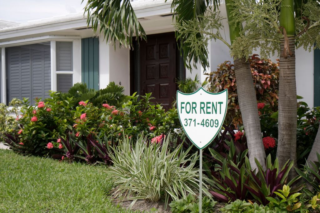 A for rent sign outside a house at Jupiter Inlet Colony.