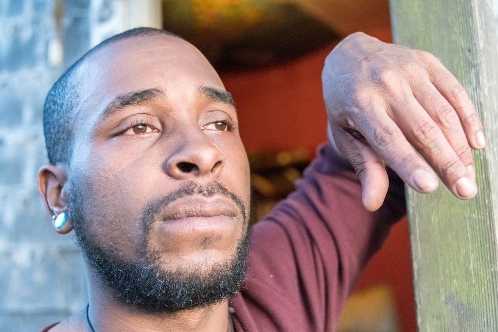 Black man looking away