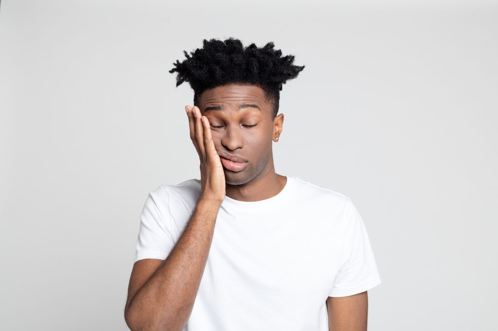 Afro american man with pain in gums