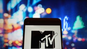The logo of music television is seen in a smartphone...