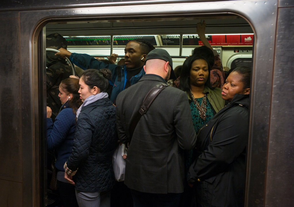 Riders On The New York City Subway