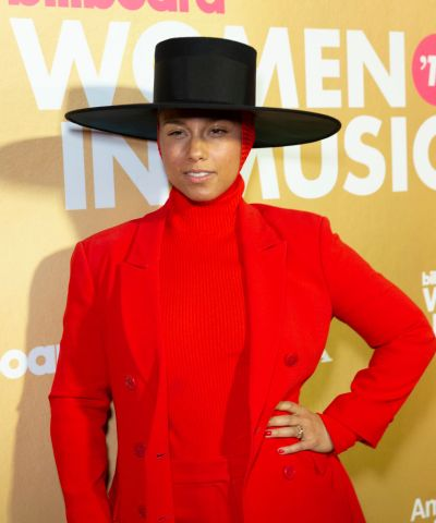 Alicia Keys wearing suit by Balenciaga attends Billboard's...