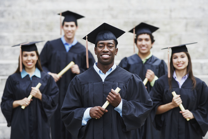 College Graduates Proudly Holding Diplomas