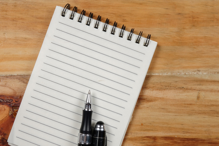 Directly Above Shot Of Note Pad With Pen On Wooden Table