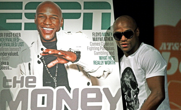 Floyd Mayweather poses with a copy of ES