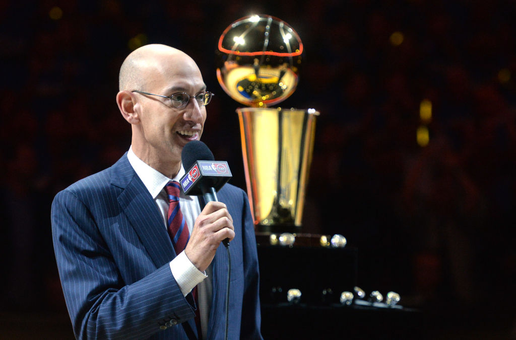 NBA Commissioner Adam Silver talks to the crowd attending the Golden State Warriors ring ceremony held before the season opener against the New Orleans Pelicans at Oracle Arena in Oakland, Calif., on Tuesday, Oct. 27, 2015. The event also featured the rai
