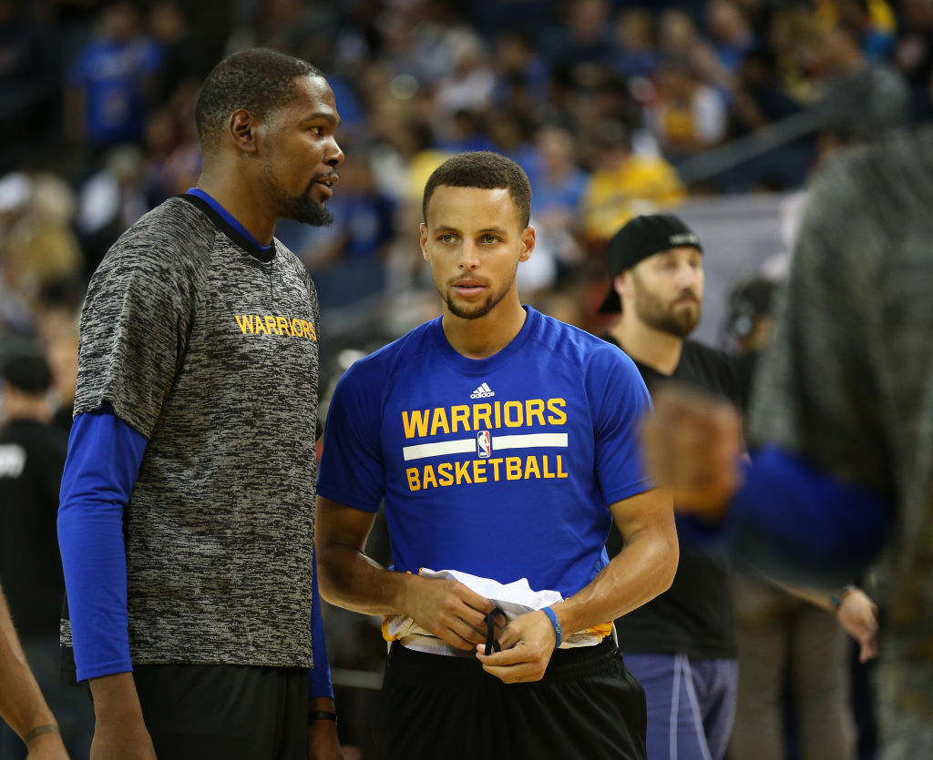Golden State Warriors' Kevin Durant (35) and Stephen Curry (30) talk as they warm up before their game against the Los Angeles Clippers at Oracle Arena in Oakland, Calif., on Tuesday, Oct. 4, 2016. (Jane Tyska/Bay Area News Group)