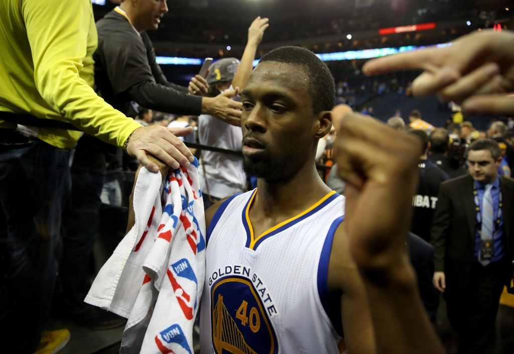 Golden State Warriors' Harrison Barnes (40) is greeted by fans as he leaves the court after their 112-101 win over the San Antonio Spurs in an NBA game at Oracle Arena in Oakland, Calif., on Thursday, April 7, 2016. (Jane Tyska/Bay Area News Group)