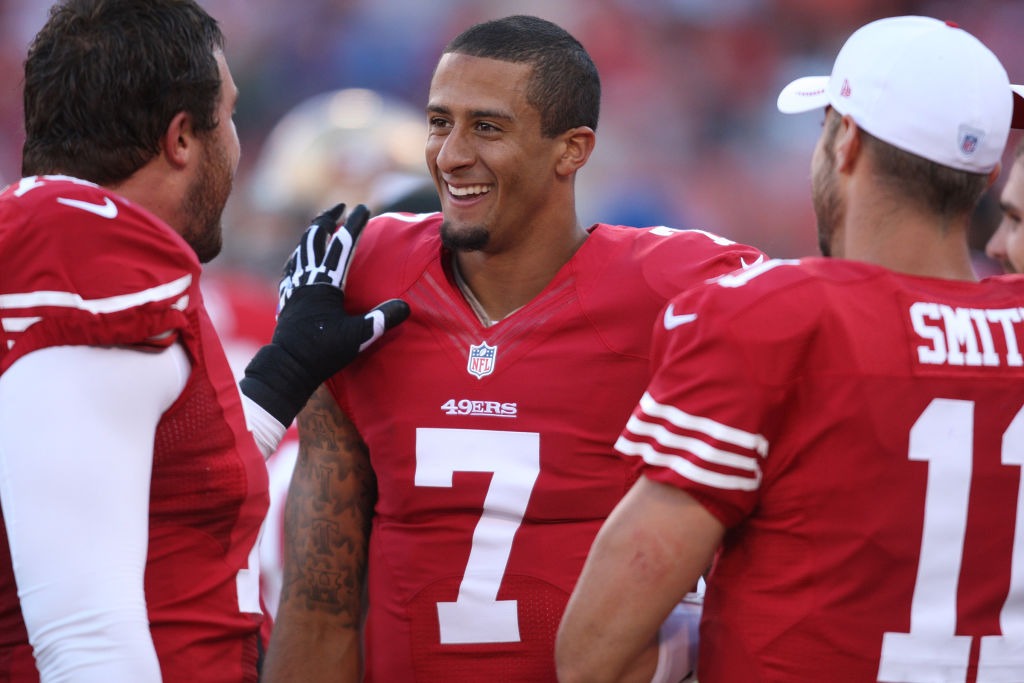 San Francisco 49ers' Colin Kaepernick is congratulated by Joe Staley after running for a 78-yard touchdown in the second quarter at Candlestick Park in San Francisco, Calif. on Friday, Aug. 10, 2012. The San Francisco 49ers played the Minnesota Vikings. (