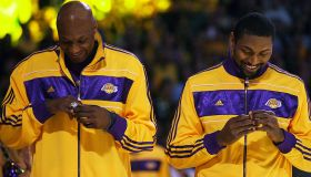 Lamar Odom (left) and Ron Artest look at their championship rings before the start of the Laker ope
