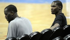 DENVER, CO--Kevin Durant, right, and Kendrick Perkins, Oklahoma City Thunder, take a breather on the bench after practice at Pepsi Center Friday afternoon. Andy Cross, The Denver Post