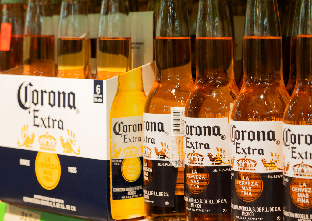 Bottles of Corona extra beer are seen on a shelf...