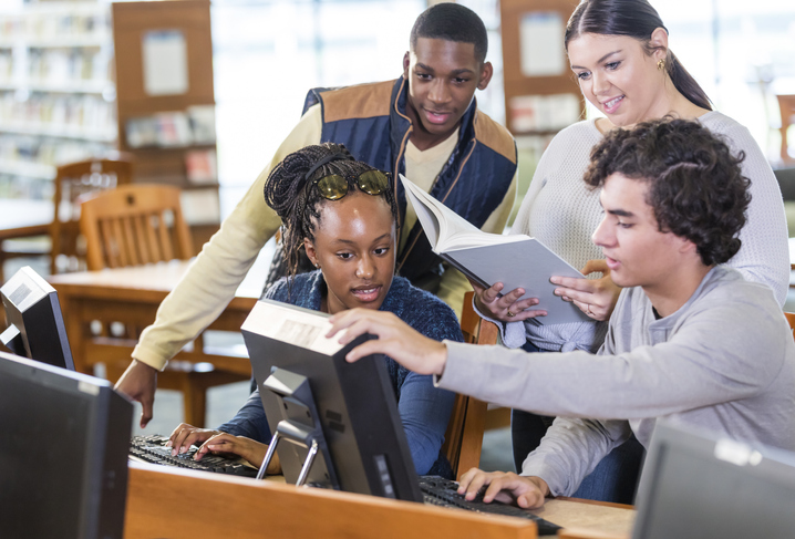 High school students in library on computers together
