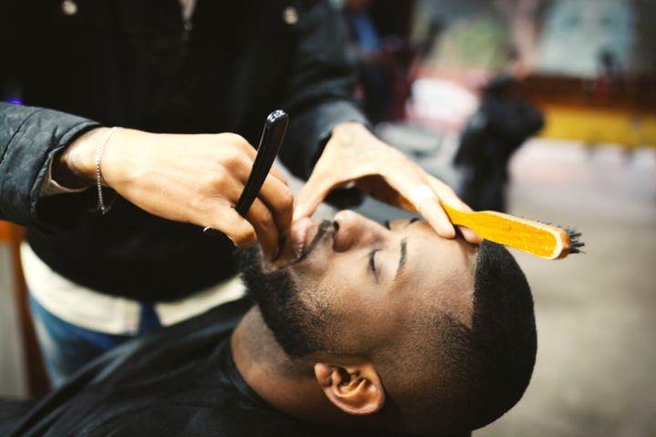Man shaving in barber shop