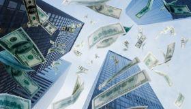 One hundred dollar bills falling from sky