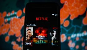 In this photo illustration a Netflix logo is seen displayed...
