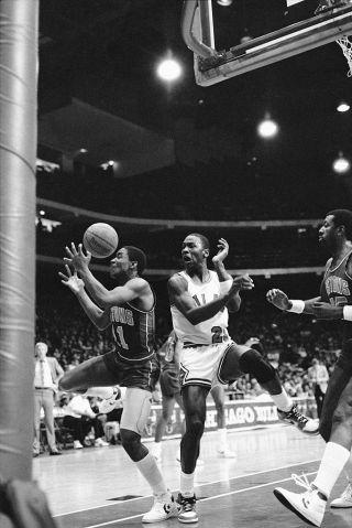 Michael Jordan and Isaiah Thomas in Game Action