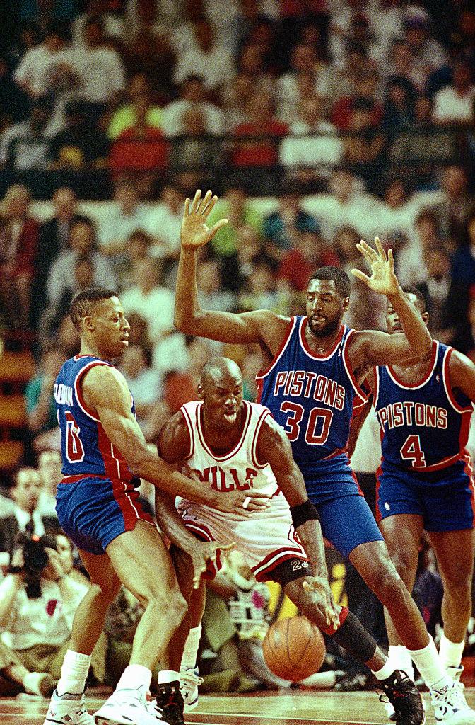 Michael Jordan Surrounded by Detroit Pistons'