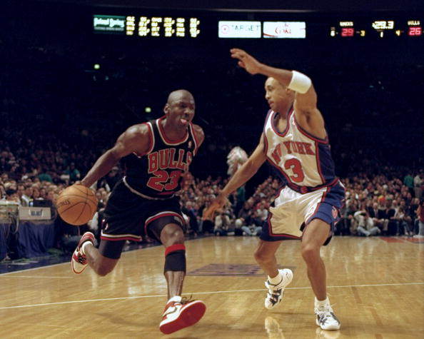 Chicago Bulls' Michael Jordan tries to get past New York Kni