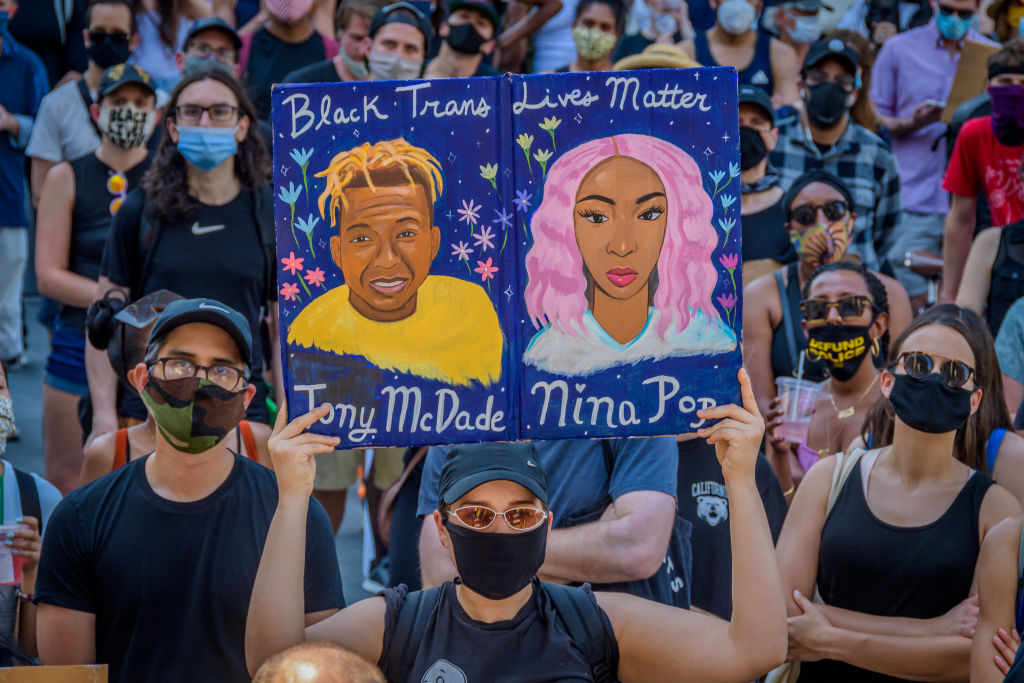 A participant holding a Black Trans Lives Matter sign at the...